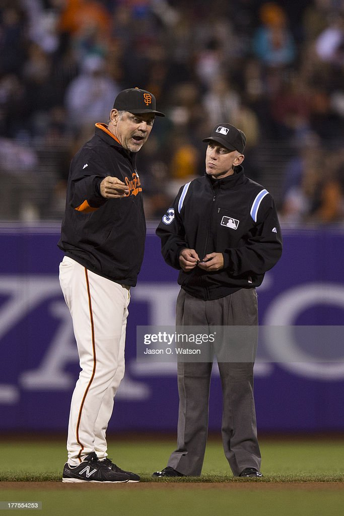 <a gi-track='captionPersonalityLinkClicked' href=/galleries/search?phrase=Bruce+Bochy&family=editorial&specificpeople=220291 ng-click='$event.stopPropagation()'>Bruce Bochy</a> #15 of the San Francisco Giants argues a call with umpire Lance Barksdale #23 where Gregor Blanco of the San Francisco Giants (not pictured) was called out attempting to steal second base against the Pittsburgh Pirates during the third inning at AT&T Park on August 23, 2013 in San Francisco, California.