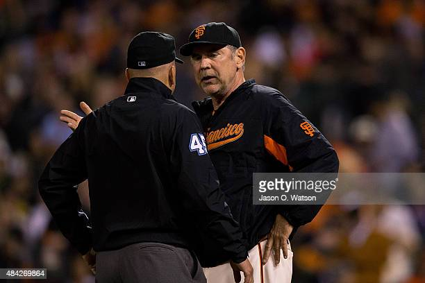 Bruce Bochy of the San Francisco Giants argues with umpire Jeff Nelson during the eighth inning against the Washington Nationals at ATT Park on...
