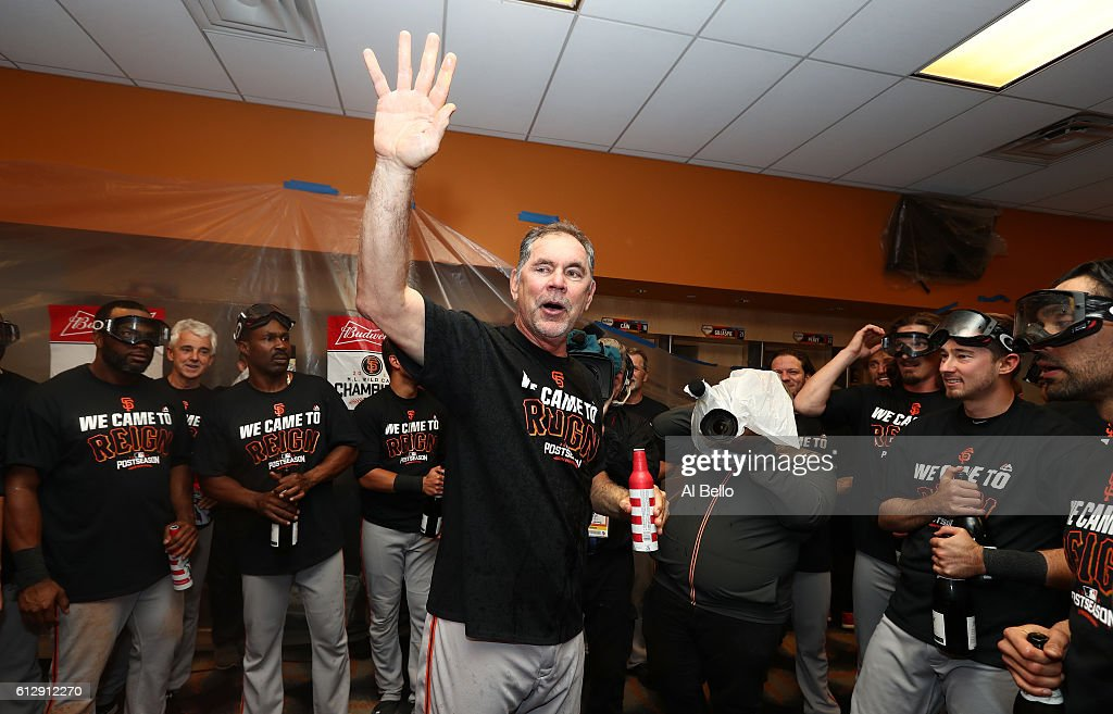 Bruce Bochy #15 of the San Francisco Giants celebrates their 3-0 victory over the New York Mets in the locker room after their National League Wild Card game at Citi Field on October 5, 2016 in New York City.