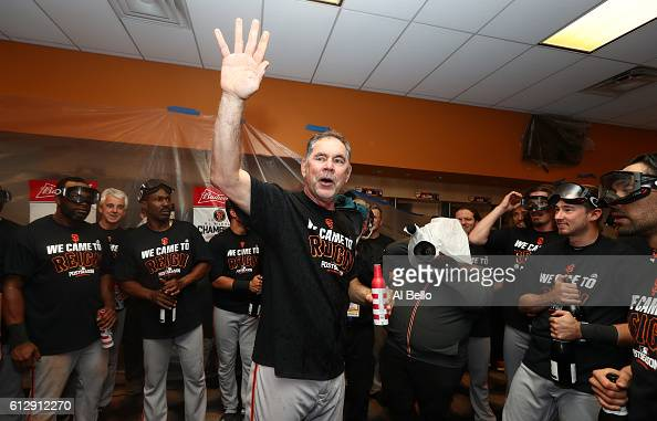 Bruce Bochy of the San Francisco Giants celebrates their 30 victory over the New York Mets in the locker room after their National League Wild Card...