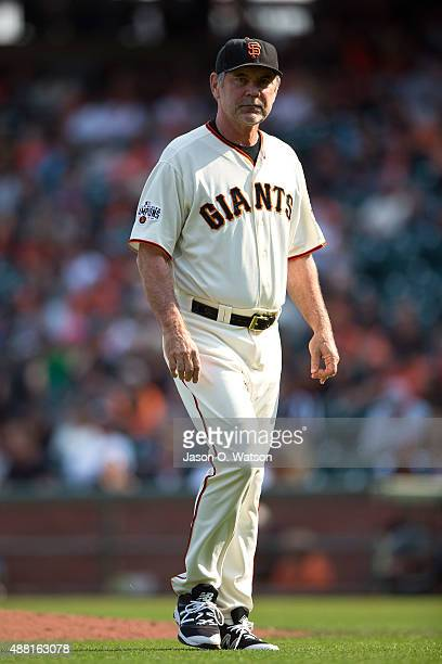 Bruce Bochy of the San Francisco Giants returns to the dugout after making a pitching change against the San Diego Padres during the ninth inning at...
