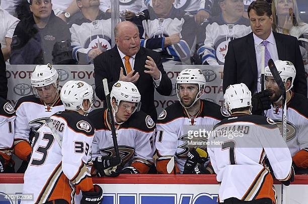 Bruce Boudreau head coach of the Anaheim Ducks gives direction from the bench during a break in third period action in Game Four of the Western...