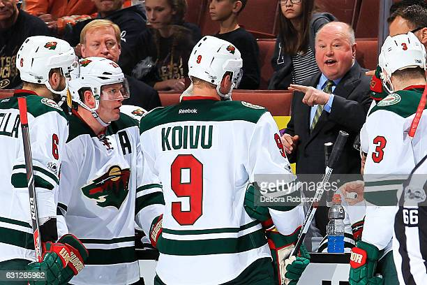 Bruce Boudreau head coach of the Minnesota Wild talks to his players during a time out in the game against the Anaheim Ducks on January 8 2017 at...