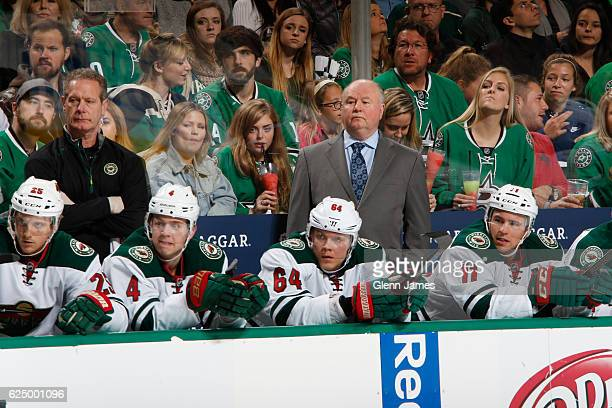 Bruce Boudreau head coach of the Minnesota Wild watches the action from the bench against the Dallas Stars at the American Airlines Center on...
