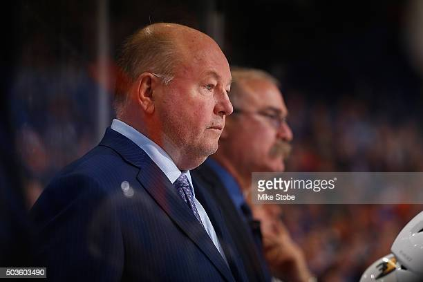 Bruce Boudreau of the Anaheim Ducks looks on from the bench against the New York Islanders at the Barclays Center on December 21 2015 in Brooklyn...