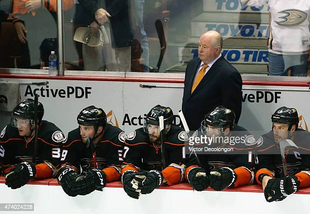 Bruce Boudreau of the Anaheim Ducks watches his team play the Chicago Blackhawks in the first period of Game Two of the Western Conference Finals...