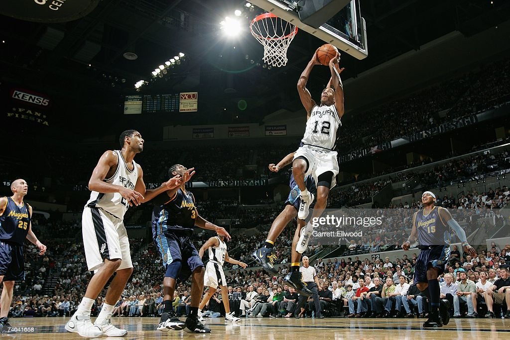 Bruce Bowen #12 of the San Antonio Spurs goes to the basket against the Denver Nuggets in Game One of the Western Conference Quarterfinals during the 2007 NBA Playoffs at AT&T Center on April 22, 2007 in San Antonio, Texas. The Nuggets won 95-89.