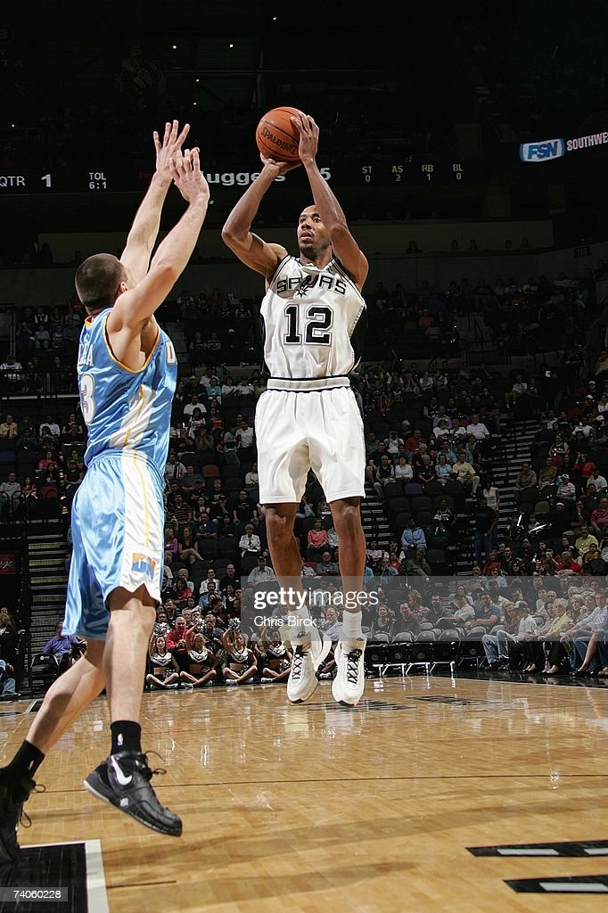 Bruce Bowen of the San Antonio Spurs shoots against Linas Kleiza of the Denver Nuggets at ATT Center on April 18 2007 in San Antonio Texas The...
