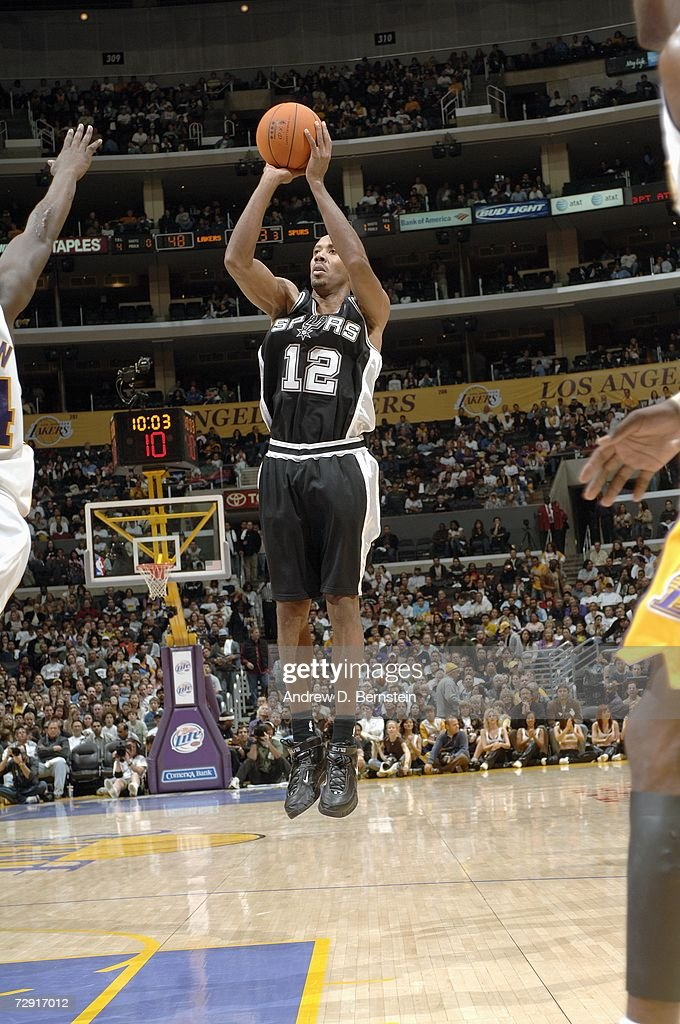 Bruce Bowen #12 of the San Antonio Spurs takes a jump shot against the Los Angeles Lakers at Staples Center on December 10, 2006 in Los Angeles, California. The Grizzlies won 106-99.