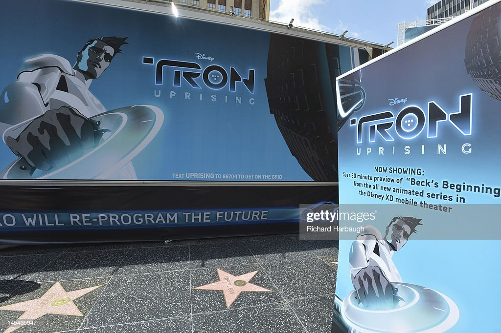 UPRISING - Bruce Boxleitner ('Tron'), Charlie Bean, executive producer and director, 'TRON: Uprising,' and David Levine, vice president and general manager, Disney XD Worldwide) unveil 'TRON: Uprising' state of the art theatre on wheels screenings at Hollywood & Highland on Saturday, May 26. 'TRON: UPRISING' THEATRE