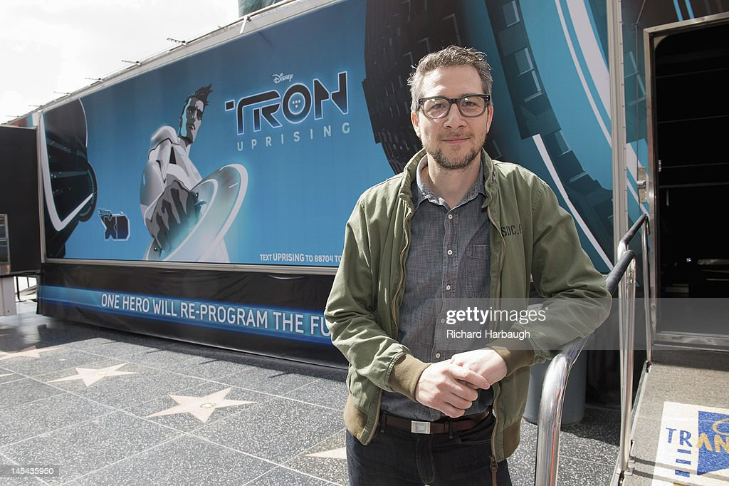 UPRISING - Bruce Boxleitner ('Tron'), Charlie Bean, executive producer and director, 'TRON: Uprising,' and David Levine, vice president and general manager, Disney XD Worldwide) unveil 'TRON: Uprising' state of the art theatre on wheels screenings at Hollywood & Highland on Saturday, May 26. BEAN