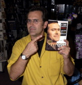 """Bruce Campbell Signs His Book """"If Chins Could Kill: Confessions of a B Movie"""