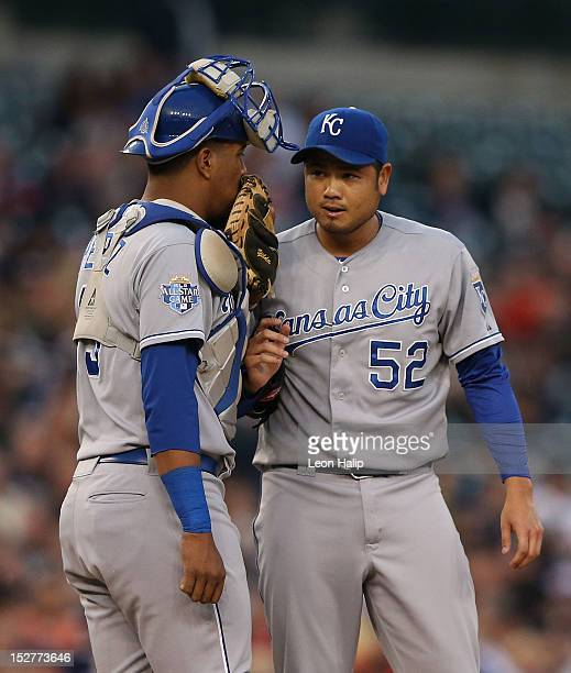 Bruce Chen and catcher Salvador Perez talk on the mound during the game against the Detroit Tigers at Comerica Park on September 25 2012 in Detroit...