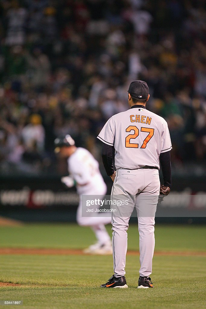 Bruce Chen #27 of the Baltimore Orioles stands on the field against the Oakland Athletics at McAfee Coliseum on August 16, 2005 in Oakland, California.