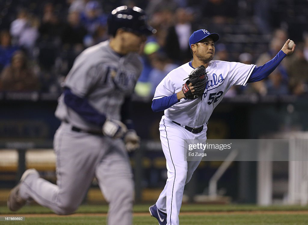 <a gi-track='captionPersonalityLinkClicked' href=/galleries/search?phrase=Bruce+Chen&family=editorial&specificpeople=213886 ng-click='$event.stopPropagation()'>Bruce Chen</a> #52 of the Kansas City Royals fields a bunt by Jose Lobaton #59 of the Tampa Bay Rays and throws to first for the out in the sixth inning at Kauffman Stadium on May 1, 2013 in Kansas City, Missouri.
