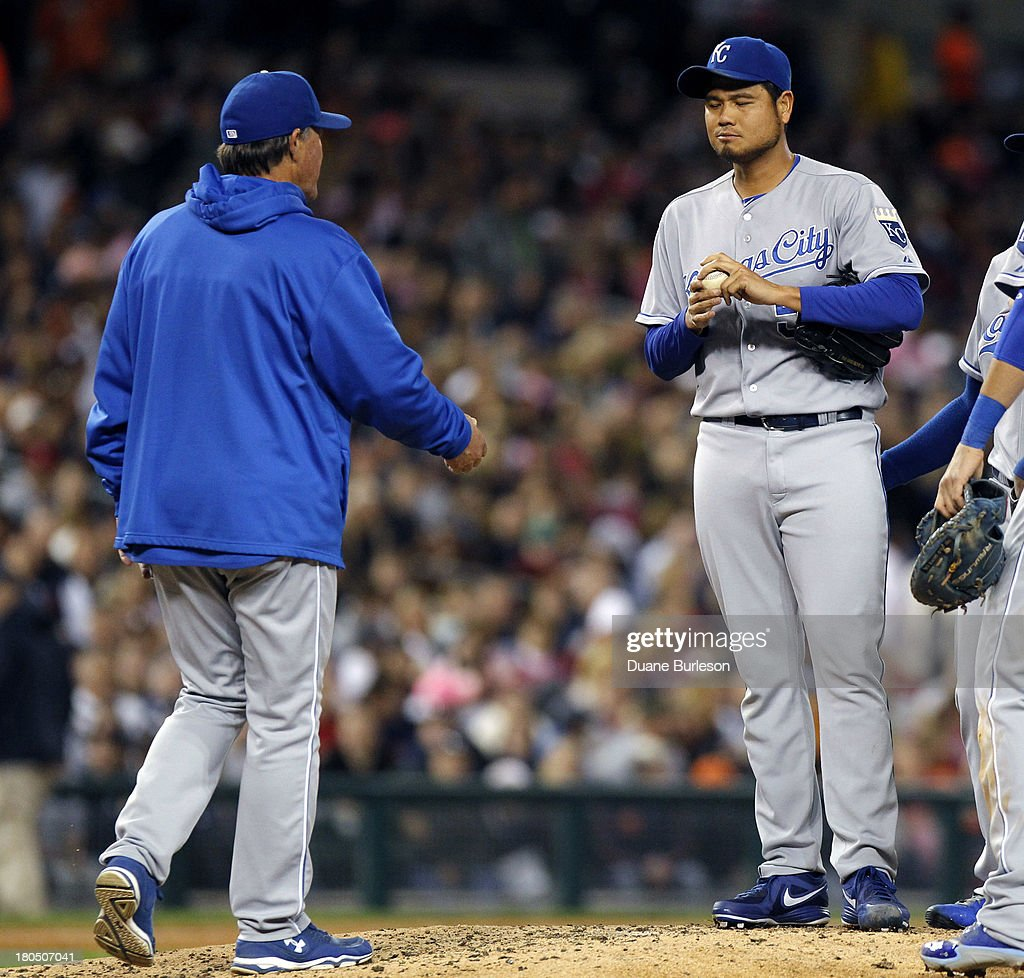<a gi-track='captionPersonalityLinkClicked' href=/galleries/search?phrase=Bruce+Chen&family=editorial&specificpeople=213886 ng-click='$event.stopPropagation()'>Bruce Chen</a> #52 of the Kansas City Royals is relieved by manager <a gi-track='captionPersonalityLinkClicked' href=/galleries/search?phrase=Ned+Yost&family=editorial&specificpeople=228571 ng-click='$event.stopPropagation()'>Ned Yost</a> #3 in the fifth inning at Comerica Park on September 13, 2013 in Detroit, Michigan.
