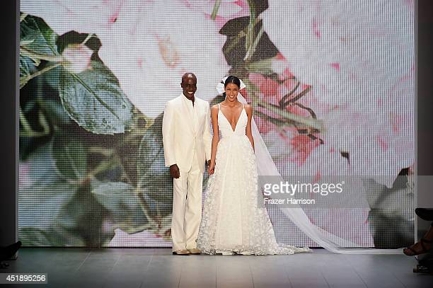 Bruce Darnell and Rebecca Mir walk the runway at the Minx by Eva Lutz show during the MercedesBenz Fashion Week Spring/Summer 2015 at Erika Hess...