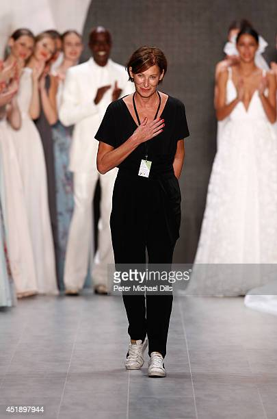 Bruce Darnell designer Eva Lutz and model Rebecca Mir appear on the runway after the Minx by Eva Lutz show during the MercedesBenz Fashion Week...