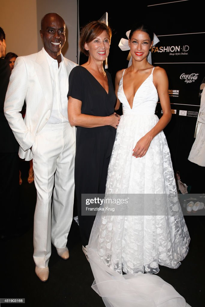 Bruce Darnell, Eva Lutz and Rebecca Mir attend the Minx by Eva Lutz show during the Mercedes-Benz Fashion Week Spring/Summer 2015 at Erika Hess Eisstadion on July 9, 2014 in Berlin, Germany.