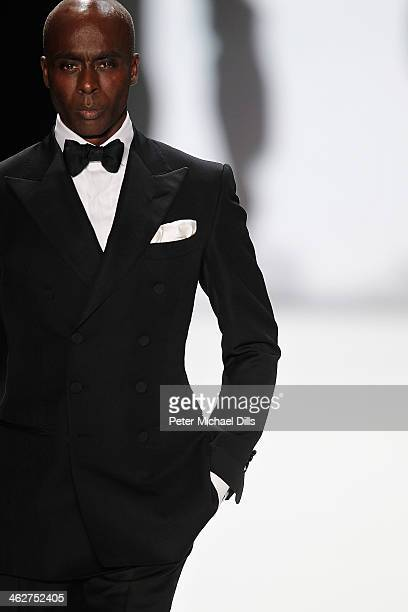Bruce Darnell walks the runway at the Minx by Eva Lutz show during MercedesBenz Fashion Week Autumn/Winter 2014/15 at Brandenburg Gate on January 15...