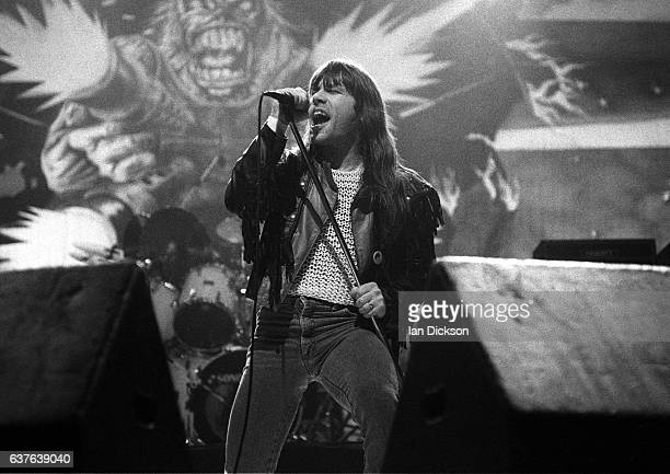 Bruce Dickinson of Iron Maiden performing on stage at Wembley Arena London 18 December 1990