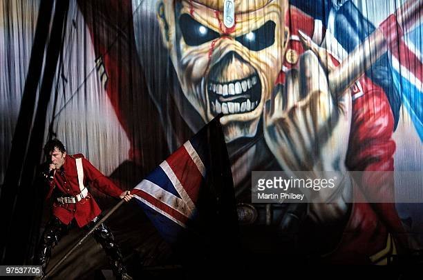 Bruce Dickinson of Iron Maiden performs on stage wearing vintage military uniform and holding a large union flag at the Rod Laver Arena on 6th Feb...