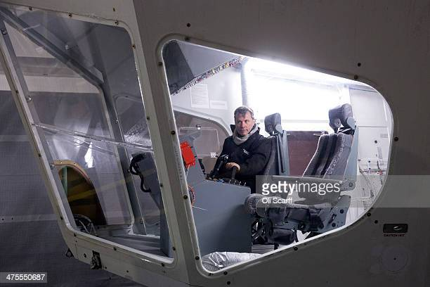 Bruce Dickinson the lead singer of the band Iron Maiden sits at the controls on the flight deck of the heliumfilled Airlander aircraft in a giant...