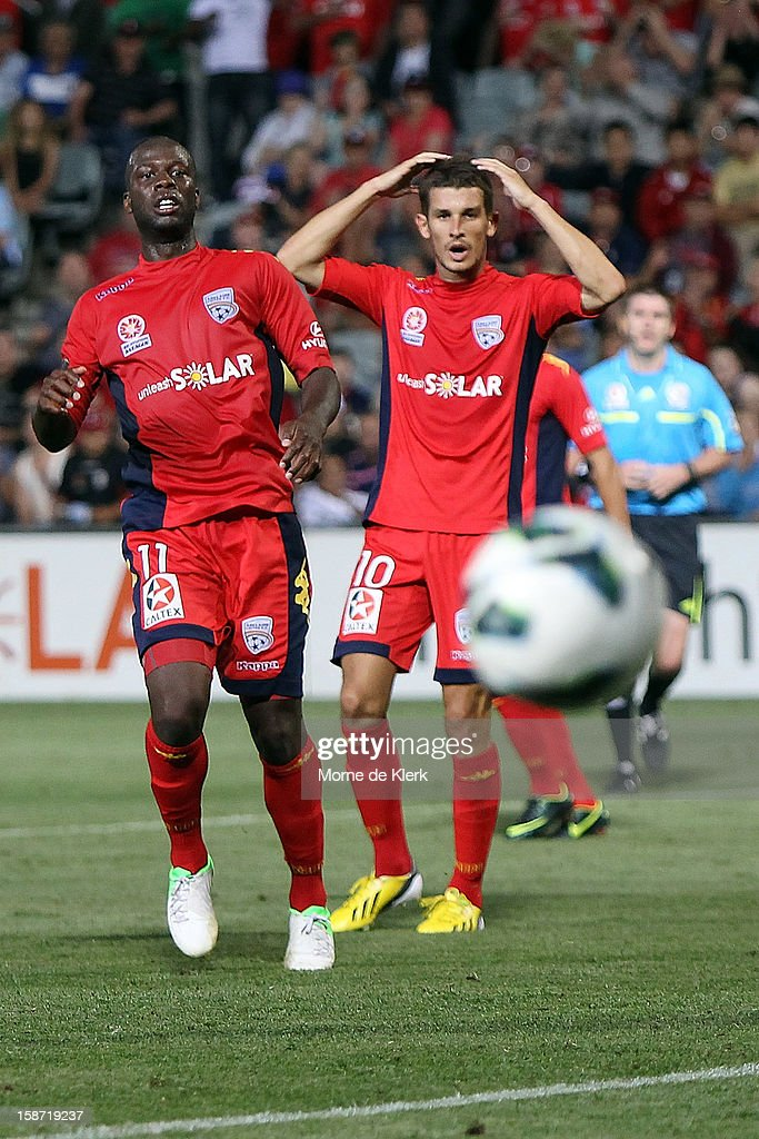 <a gi-track='captionPersonalityLinkClicked' href=/galleries/search?phrase=Bruce+Djite&family=editorial&specificpeople=775797 ng-click='$event.stopPropagation()'>Bruce Djite</a> and Dario Vidosic of Adelaide react after a missed shot on goal by Djite during the round 13 A-League match between Adelaide United and the Brisbane Roar at Hindmarsh Stadium on December 26, 2012 in Adelaide, Australia.