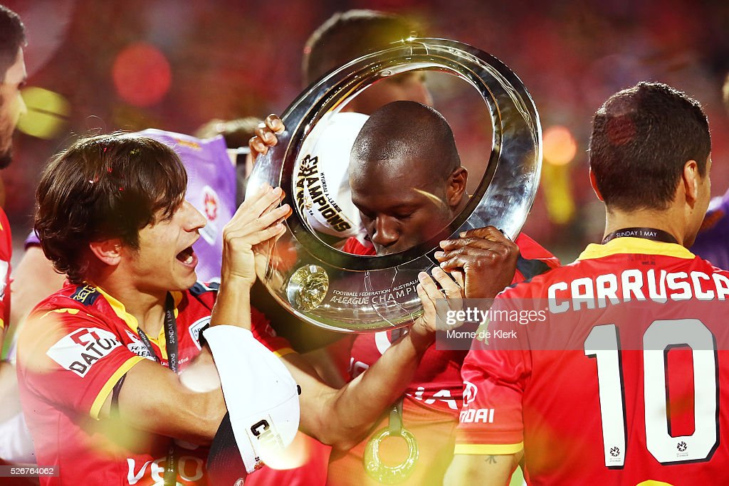 Bruce Djite and Pablo Sanchez Adelaide United celebrate with the trophy during the 2015/16 A-League Grand Final match between Adelaide United and the Western Sydney Wanderers at the Adelaide Oval on May 1, 2016 in Adelaide, Australia.