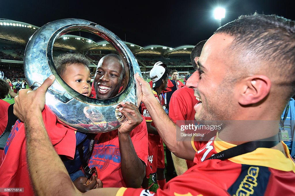 Bruce Djite and Tarek Elrich of United celebrate after United defeated the Wanderers after the 2015/16 A-League Grand Final match between Adelaide United and the Western Sydney Wanderers at Adelaide Oval on May 1, 2016 in Adelaide, Australia.