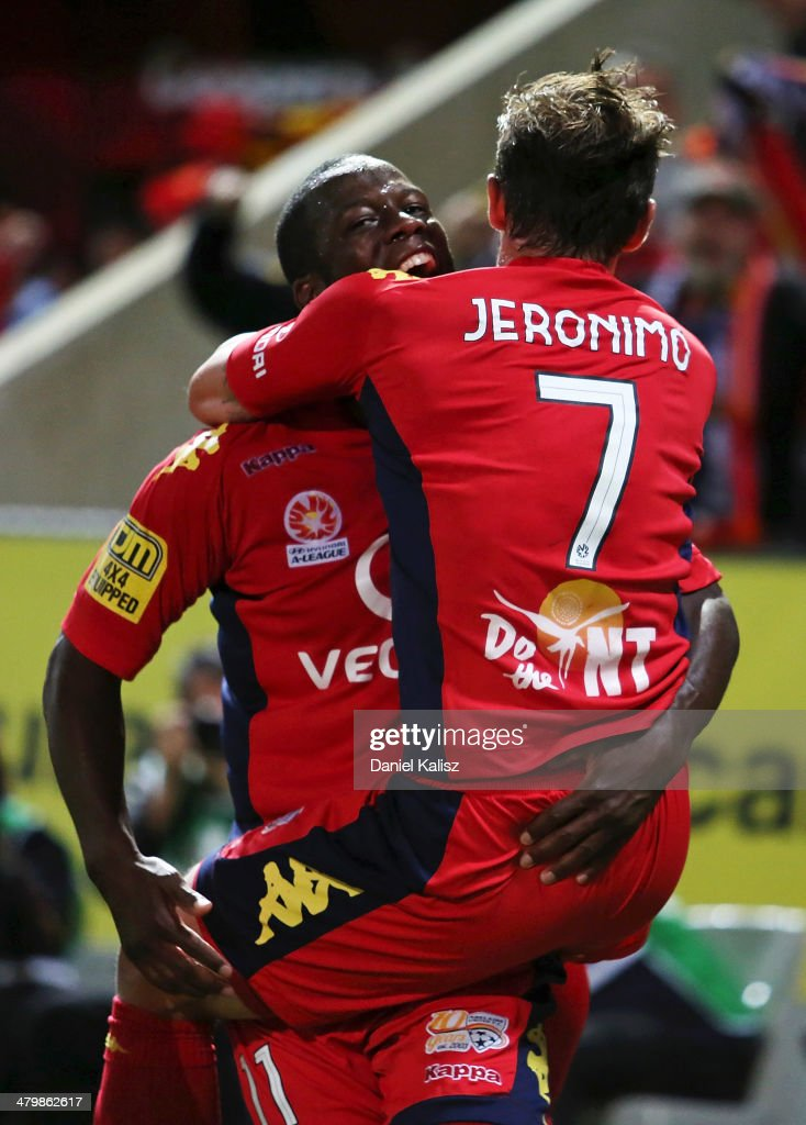 Bruce Djite (L) celebrates with Jeronimo Neumann of United during the round 24 A-League match between Adelaide United and Sydney FC at Coopers Stadium on March 21, 2014 in Adelaide, Australia.