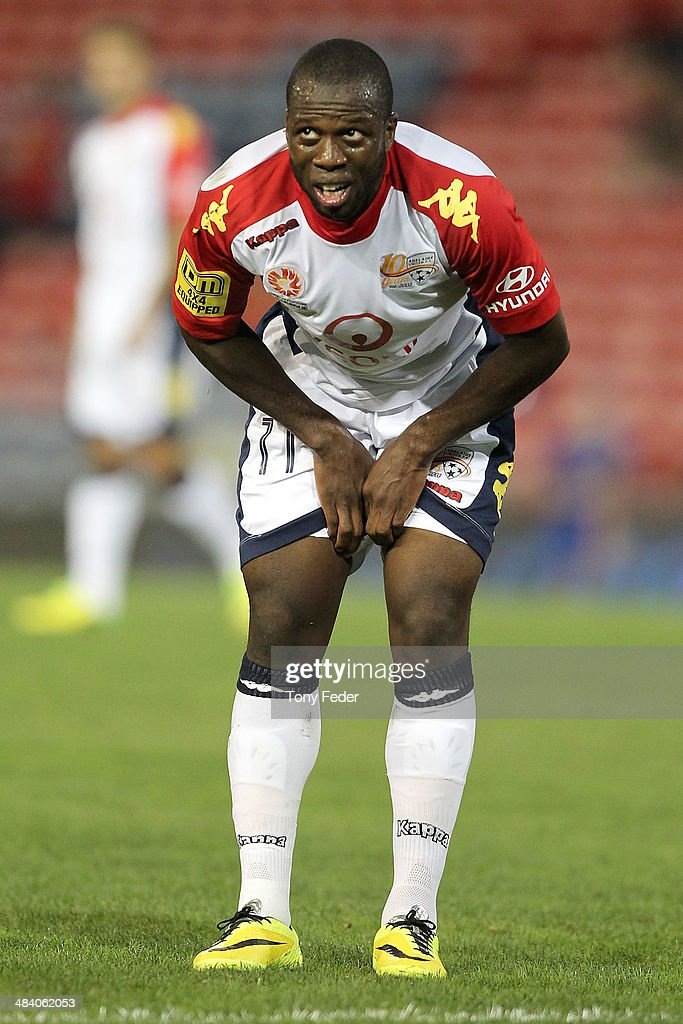 Bruce Djite of Adelaide in pain during the round 27 A-League match between the Newcastle Jets and Adelaide United at Hunter Stadium on April 11, 2014 in Newcastle, Australia.
