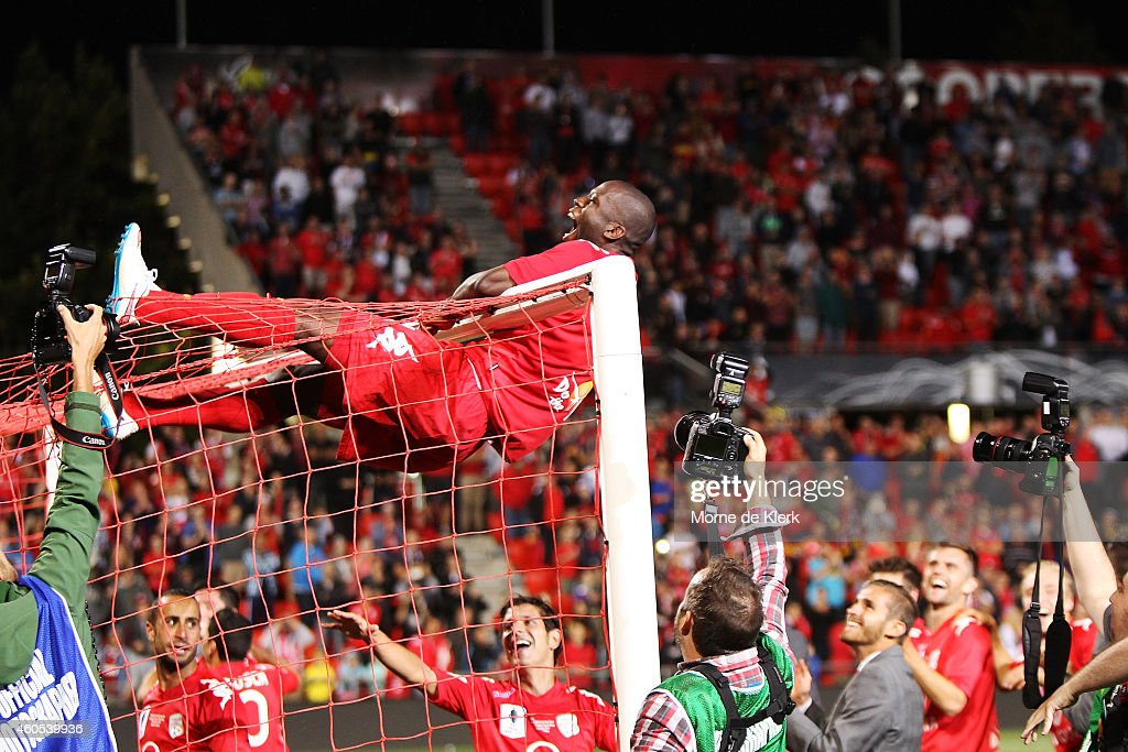 Bruce Djite (#11) of Adelaide United celebrate after Adelaide won the FFA Cup Final match between Adelaide United and Perth Glory at Coopers Stadium on December 16, 2014 in Adelaide, Australia.