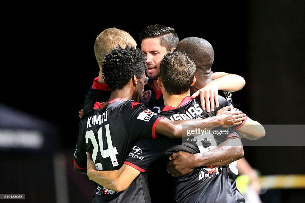 <a gi-track='captionPersonalityLinkClicked' href=/galleries/search?phrase=Bruce+Djite&family=editorial&specificpeople=775797 ng-click='$event.stopPropagation()'>Bruce Djite</a> of Adelaide United celebrates a goal with team mates during the round 19 A-League match between the Central Coast Mariners and Adelaide United at Central Coast Stadium on February 14, 2016 in Gosford, Australia.