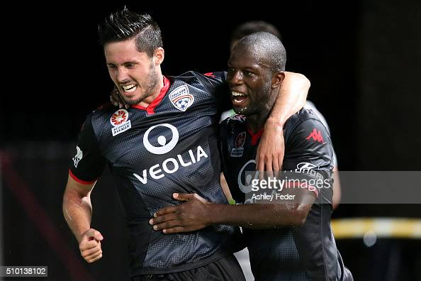 Bruce Djite of Adelaide United celebrates a goal with team mates during the round 19 ALeague match between the Central Coast Mariners and Adelaide...