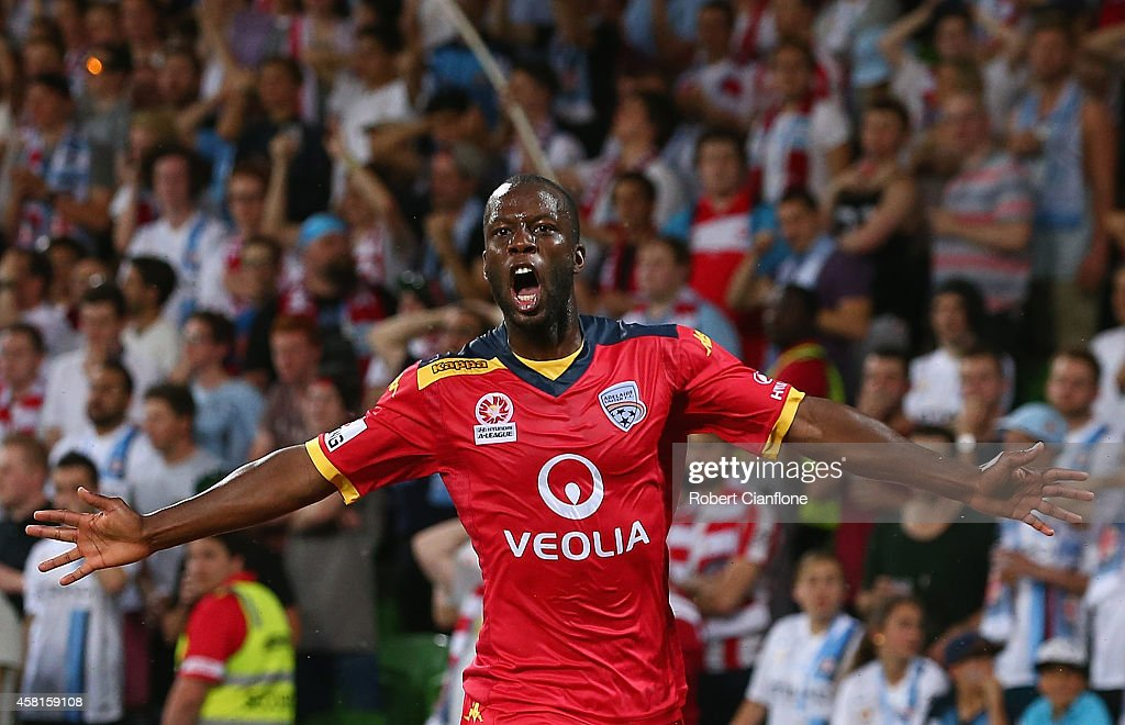 Bruce Djite of Adelaide United celebrates after scoring a goal during the round four ALeague match between Melbourne City and Adelaide United at AAMI...