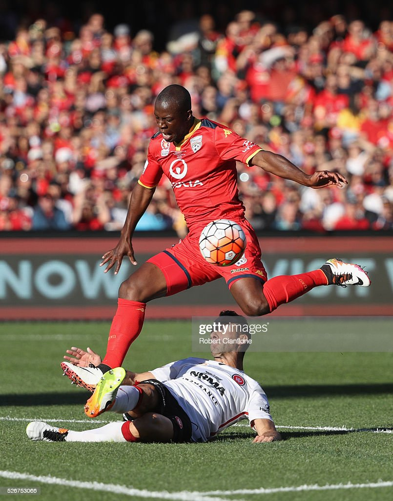 Bruce Djite of Adelaide United is challenged by Alberto of the Wanderers during the 2015/16 A-League Grand Final match between Adelaide United and the Western Sydney Wanderers at Adelaide Oval on May 1, 2016 in Adelaide, Australia.