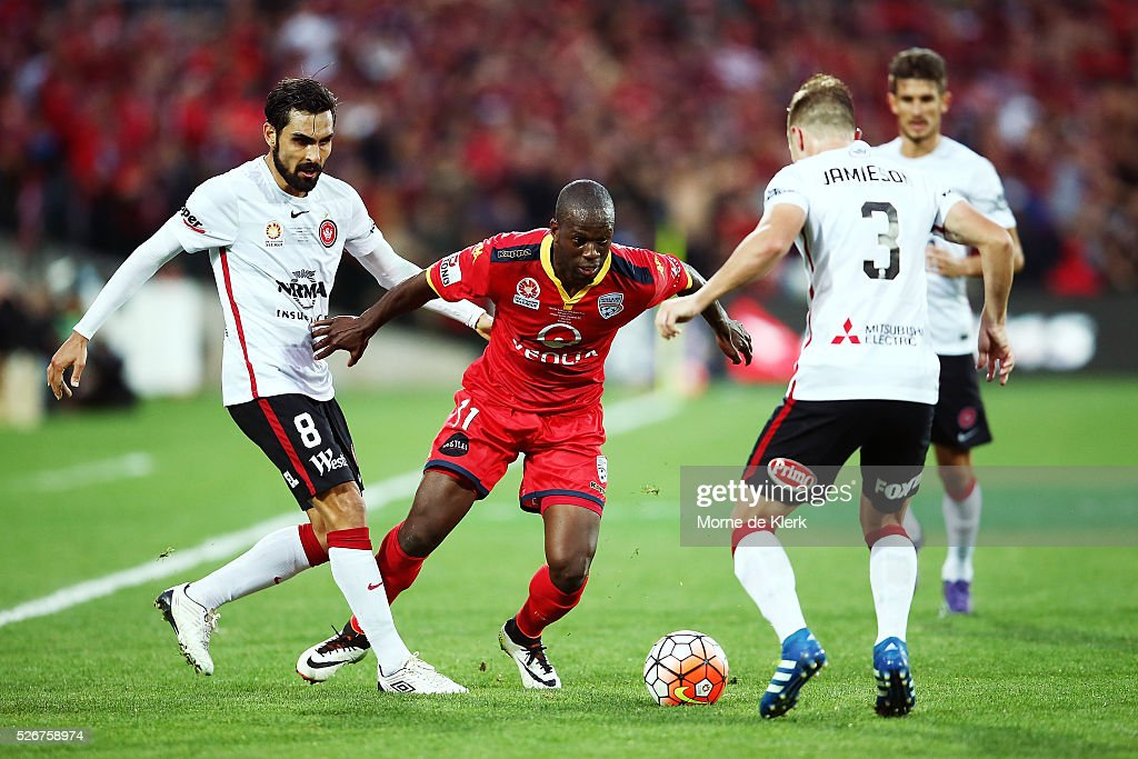 Bruce Djite of Adelaide United wins the ball during the 2015/16 A-League Grand Final match between Adelaide United and the Western Sydney Wanderers at the Adelaide Oval on May 1, 2016 in Adelaide, Australia.