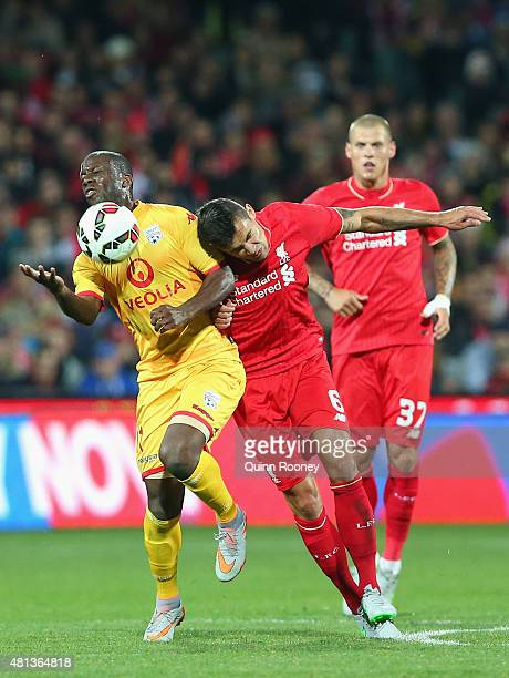 Bruce Djite of United and Dejan Lovren of Liverpool FC compete for the ball during the international friendly match between Adelaide United and...