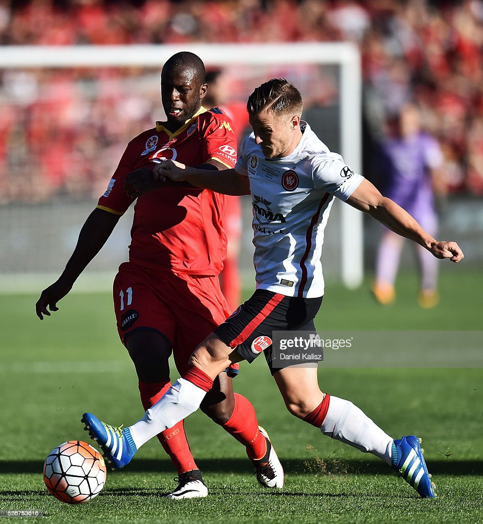 Bruce Djite of United and Scott Jamieson of the Wanderers compete for the ball during the 2015/16 A-League Grand Final match between Adelaide United and the Western Sydney Wanderers at Adelaide Oval on May 1, 2016 in Adelaide, Australia.
