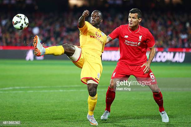 Bruce Djite of United is challenged by Dejan Lovren of Liverpool during the international friendly match between Adelaide United and Liverpool FC at...