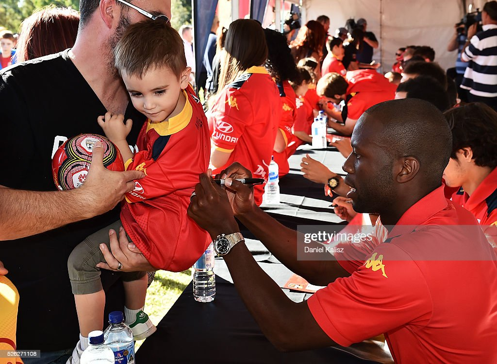 <a gi-track='captionPersonalityLinkClicked' href=/galleries/search?phrase=Bruce+Djite&family=editorial&specificpeople=775797 ng-click='$event.stopPropagation()'>Bruce Djite</a> of United signs an autograph for a fan during the A-League Grand Final Fan Day at Bonython Park on April 30, 2016 in Adelaide, Australia.