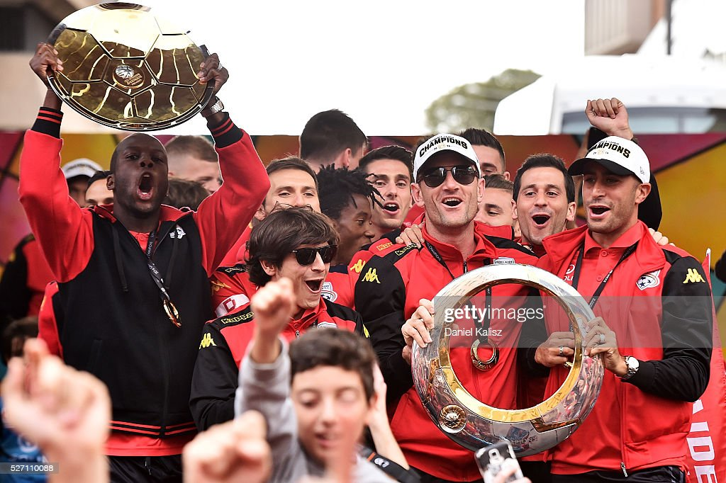 Bruce Djite, Pablo Sanchez Alberto, Eugene Galekovic and Tarek Elrich of United celebrate with fans during the Adelaide United A-League Grand Final at Rundle Mall on May 2, 2016 in Adelaide, Australia.