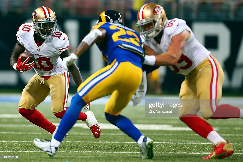 <a gi-track='captionPersonalityLinkClicked' href=/galleries/search?phrase=Bruce+Ellington&family=editorial&specificpeople=7405384 ng-click='$event.stopPropagation()'>Bruce Ellington</a> #10 carries the ball as <a gi-track='captionPersonalityLinkClicked' href=/galleries/search?phrase=Vance+McDonald&family=editorial&specificpeople=7179764 ng-click='$event.stopPropagation()'>Vance McDonald</a> #89 of the San Francisco 49ers defends against <a gi-track='captionPersonalityLinkClicked' href=/galleries/search?phrase=Trumaine+Johnson&family=editorial&specificpeople=3915425 ng-click='$event.stopPropagation()'>Trumaine Johnson</a> #22 of the St. Louis Rams in the first quarter at the Edward Jones Dome on November 1, 2015 in St. Louis, Missouri.