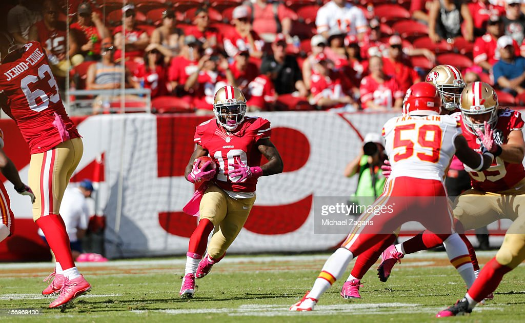 <a gi-track='captionPersonalityLinkClicked' href=/galleries/search?phrase=Bruce+Ellington&family=editorial&specificpeople=7405384 ng-click='$event.stopPropagation()'>Bruce Ellington</a> #10 of the San Francisco 49ers returns a kickoff during the game against the Kansas City Chiefs at Levi Stadium on October 5, 2014 in Santa Clara, California. The 49ers defeated the Chiefs 22-17.
