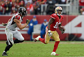 Bruce Ellington of the San Francisco 49ers runs with the ball while pursued by Kroy Biermann of the Atlanta Falcons during their NFL game at Levi's...