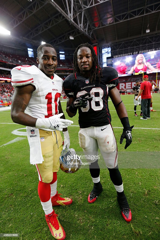 <a gi-track='captionPersonalityLinkClicked' href=/galleries/search?phrase=Bruce+Ellington&family=editorial&specificpeople=7405384 ng-click='$event.stopPropagation()'>Bruce Ellington</a> #10 of the San Francisco 49ers stands with <a gi-track='captionPersonalityLinkClicked' href=/galleries/search?phrase=Andre+Ellington&family=editorial&specificpeople=5519153 ng-click='$event.stopPropagation()'>Andre Ellington</a> #38 of the Arizona Cardinals on the field following the game at the University of Phoenix Stadium on September 21, 2014 in Glendale, Arizona. The Cardinals defeated the 49ers 23-14.