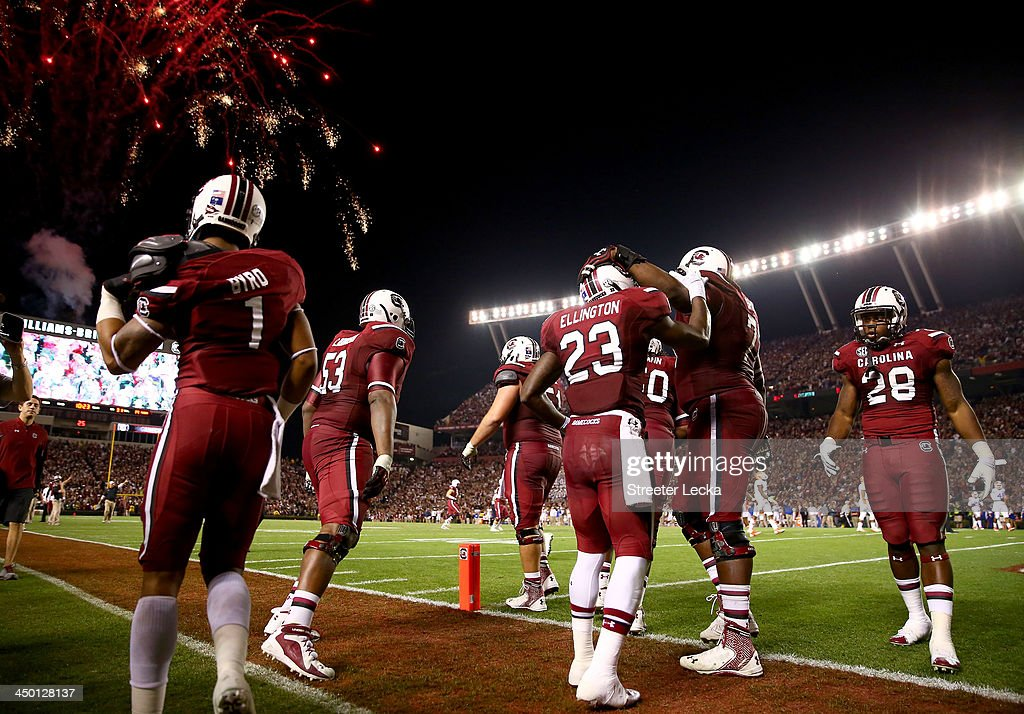 Bruce Ellington #23 of the South Carolina Gamecocks celebrates with teammates after scoring a touchdown during their game against the Florida Gators at Williams-Brice Stadium on November 16, 2013 in Columbia, South Carolina.