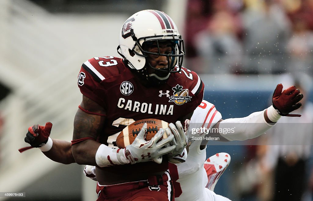 Bruce Ellington of the South Carolina Gamecocks hauls in a 39 yard touchdown pass during the first half of their game against the Wisconsin Badgers...