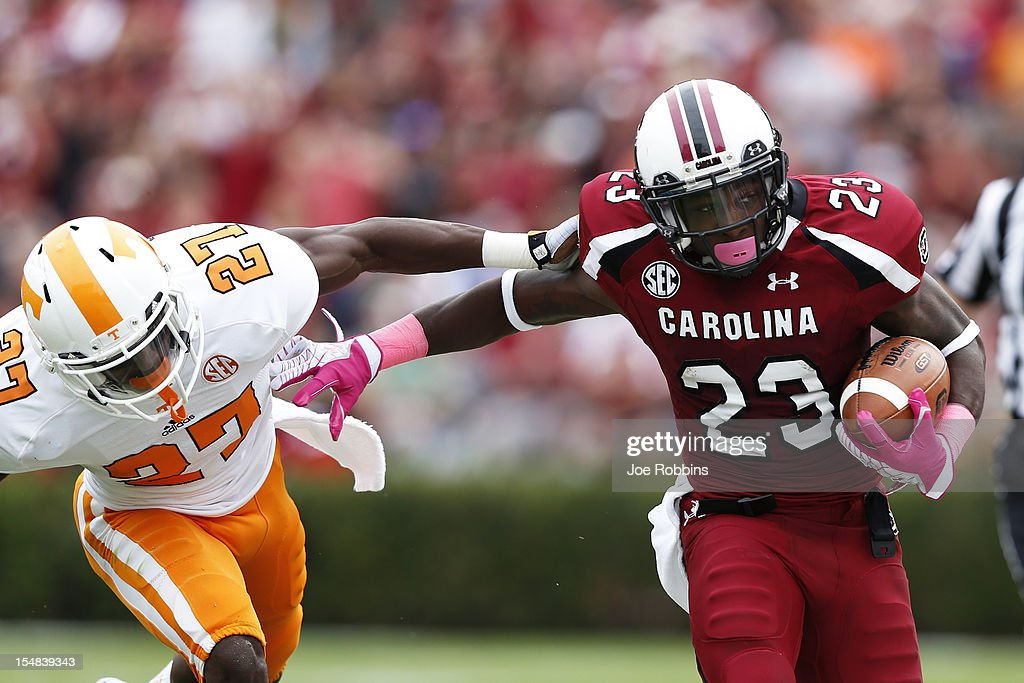 Bruce Ellington #23 of the South Carolina Gamecocks runs downfield after catching a pass against Justin Coleman #27 of the Tennessee Volunteers during the game at Williams-Brice Stadium on October 27, 2012 in Columbia, South Carolina. South Carolina won 38-35.